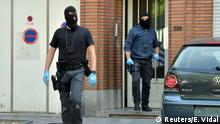 21.06.2017+++ Belgian policeman get out of a house after searching it, following yesterday's attack, in Brussels, Belgium June 21, 2017. REUTERS/Eric Vidal