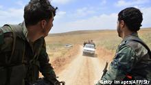 Syrian regime forces drive on May 9, 2015 near Assal al-Ward, a small regime-controlled village situated on the mountain of al-Kanissa in the Qalamun region, after they seized control of several hilltops in the mountainous area that straddles the Syria-Lebanon border with the support of Lebanon's Shiite Hezbollah movement. Pro-government forces have been battling rebel groups and Al-Qaeda affiliate Al-Nusra Front in the Qalamun region, which lies north of Damascus. AFP PHOTO / STR (Photo credit should read STR/AFP/Getty Images)