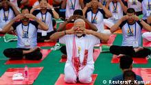 21.06.2017+++ Indian Prime Minister Narendra Modi performs yoga on International Yoga Day in Lucknow, India June 21, 2017. REUTERS/Pawan Kumar