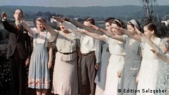 Hitler youth saluting Adolf Hitler