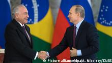 3135851 06/21/2017 June 21, 2017. Russian President Vladimir Putin and Brazilian President Michel Temer, left, at a news conference following a meeting in the Kremlin. Sergey Guneev/Sputnik Foto: Sergey Guneev/Sputnik/dpa |