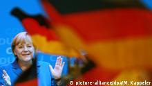 Deutschland Angela Merkel mit deutscher Flagge