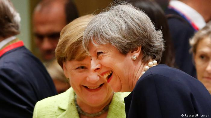Theresa May and Angela Merkel laughing at EU summit (Reuters/F. Lenoir)