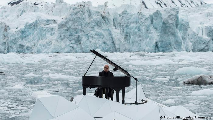 Pianist Ludovico Einaudi plays in the Arctic. Photo credit: Picture-Alliance/dpa/P. Armestre.