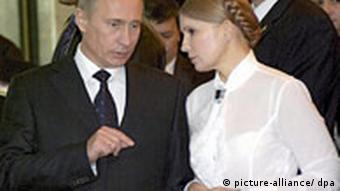 The Prime Minister of Russia Vladimir Putin (L) talks with his Ukrainian counterpart Yulia Timoshenko