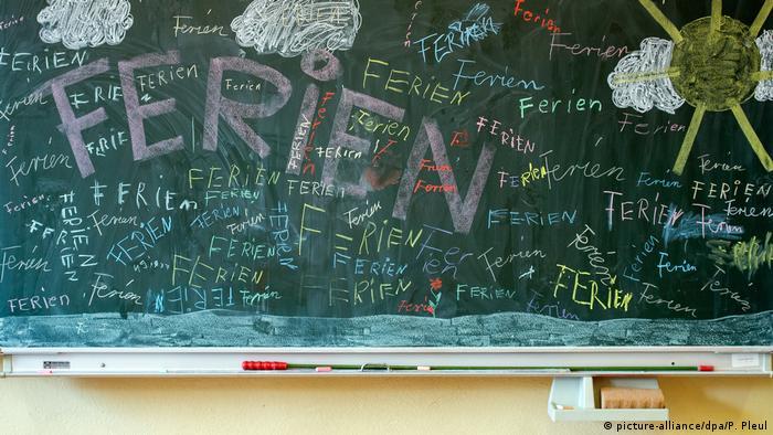 A blackboard filled with the word Ferien written in chalk