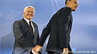 German Foreign Minister Frank-Walter Steinmeier, left, taking by the hand by now US President Barack Obama