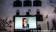 A view of a computer screen showing a digital portrait of the Turkish Prime Minister Recep Tayyip Erdogan and text reading Yes we ban on a laptop computer screen, in front of graffiti in Istanbul, on March 27, 2014. Turkey banned video-sharing website YouTube today, having blocked Twitter a week earlier after both were used to spread audio recordings damaging to the government, local media reported. The move came hours after the release of an audio file on YouTube, purporting to be of a security meeting in which top government, military and spy officials discuss a possible scenario for military action inside Syria. AFP PHOTO / OZAN KOSE (Photo credit should read OZAN KOSE/AFP/Getty Images)