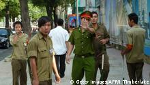 A police officer outside the Ho Chi Minh City People's Court (Getty Images/AFP/I. Timberlake)