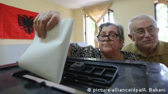 Two people voting in Albanian elections