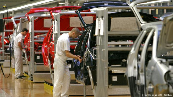 Workers assemble Volkswagen Polo compact cars October 29, 2003 at the Volkswagen factory just outside Bratislava, Slovakia.