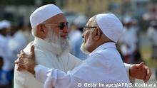 26.06.2017***** Sri Lankan Muslim devotees embrace after offering Eid al-Fitr prayers at the Galle Face esplanade in Colombo on June 26, 2017. Muslims around the world are celebrating Eid al-Fitr which marks the end of the holy month of Ramadan, after the sighting of the new crescent moon. / AFP PHOTO / Ishara S. KODIKARA (Photo credit should read ISHARA S. KODIKARA/AFP/Getty Images)