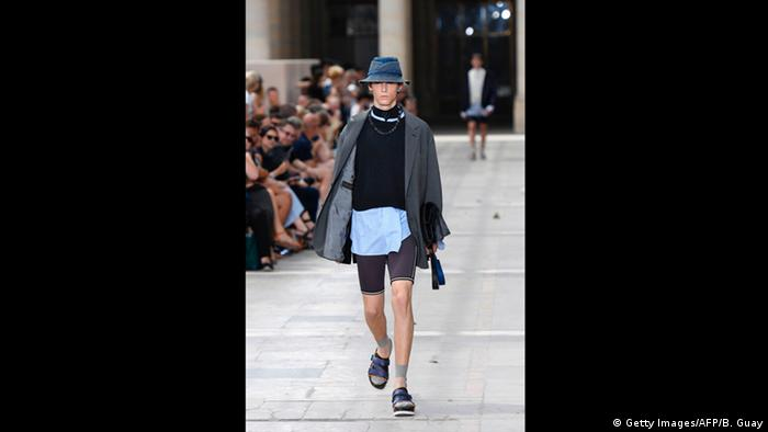 Men's Fashion Week, model with hat, coat, shorts, socks and sandals by Louis Vuitton (Getty Images/AFP/B. Guay)