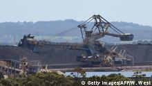 To go with Climate-warming-UN-COP21-Australia-coal,FEATURE by Madeleine Coorey A photo taken on November 18, 2015, shows part of the coal operations at the Port of Newcastle as Australia plans to dramatically ramp up coal exports -- which is the nation's second most valuable export -- to boost economic growth over the next decade despite climate change activists arguing new planned mines are carbon bombs incompatible with limiting temperature rises. As the world meets for climate change at talks in Paris, environmentalists say hopes of curbing global warming to less than two degrees Celsius (3.6 Farenheit) are incompatible with Australia's coal expansion plans. AFP PHOTO / William WEST / AFP / WILLIAM WEST (Photo credit should read WILLIAM WEST/AFP/Getty Images)