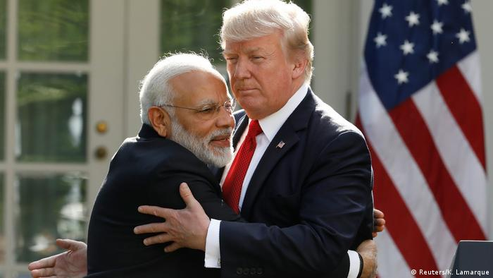 US President Donald Trump and India's Prime Minister Nerendra Modi hug in front of the White House.