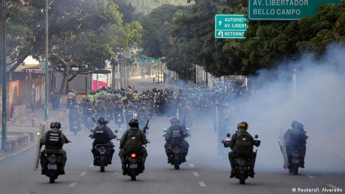 Security forces ride on motorcycles during a rally against Venezuela's President Nicolas Maduro's government in Caracas