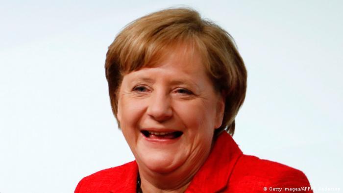 Angela Merkel lacht (Getty Images/AFP/O. Andersen)