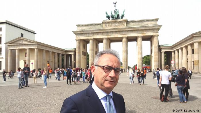 Aferof Neofytou, chairman of the conservative Greek Cypriot Democratic Rally party, stands before the Brandenburg gate in Berlin