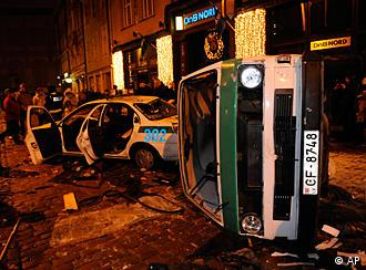 Damaged police cars are seen on the street during an anti-government rally in Riga's historic Old Town, Latvia, Tuesday, Jan. 13, 2009.