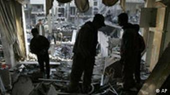 Palestinians inspect the damage