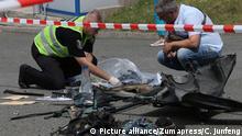KIEV, June 27, 2017 Investigators inspect the site of car blast in Kiev, capital of Ukraine, June 27, 2017. A senior Ukrainian intelligence officer was killed on Tuesday in a car blast in the capital city of Kiev, the Ukrainian Defense Ministry said in a statement. zhf  