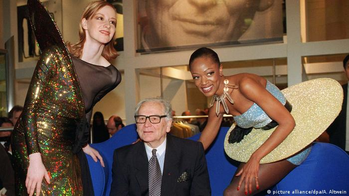 Pierre Cardin at the age of 75, flanked by two models