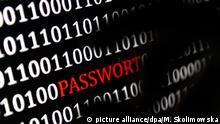 ILLUSTRATION - Eine Hand greift nach dem Wort «Passwort», das auf einem Computerbildschirm am 26.01.2017 in Berlin angezeigt wird. Foto: Monika Skolimowska/dpa   Verwendung weltweit