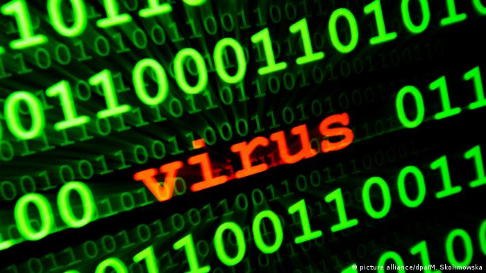 Symbol picture of a virus with green text on a computer display (picture alliance/dpa/M. Skolimowska)