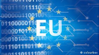 The letters EU surrounded by golden stars on a blue background showing computer code