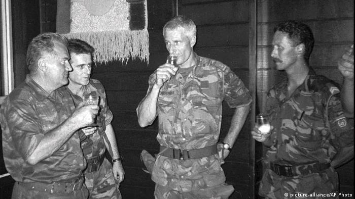 Ratko Mladic (left), Bosnian Serb military general, seen with Dutch military commander Ton Karremans (second from right), shortly before the Srebrenica massacre