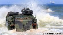 U.S. navy amphibious assault vehicles enter the sea during annual recurring multinational, maritime-focused NATO exercise BALTOPS 2017, near Ventspils, Latvia, June 6, 2017. REUTERS/Ints Kalnins