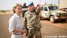 FILE PHOTO: German Defence Minister Ursula von der Leyen speaks to German army Bundeswehr lieutenant colonel Michael Hoppstaedter during a visit to Camp Castor in Gao, Mali