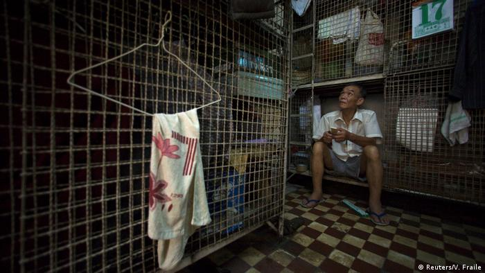 2008: No place to live Soaring property prices in Hong Kong forced rents higher. By 2008, it wasn't unusual to see people like Kong Siu-kau living in so-called cage homes, 15-square-foot (1.4 square meters) wire mesh cubicles, eight of which were usually crammed into one room. Today an estimated 200,000 people call a wire cage, or a single bed in a shared apartment, home.