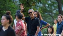Former President Barack Obama (C) waves while walking with his daughter Malia during a visit to the 9th-century Borobudur Temple in Magelang, Central Java, Indonesia June 28, 2017. REUTERS/Pius Erlangga