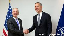 U.S. Secretary of Defense Mattis and NATO Secretary-General Stoltenberg pose during a NATO defence ministers meeting in Brussels