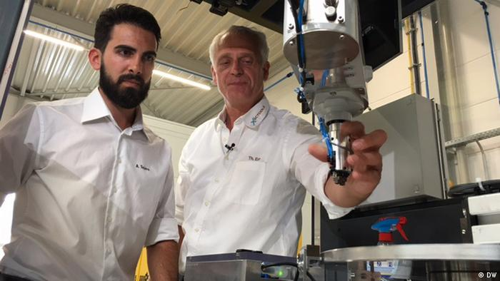 A young Spanish man learns the ropes at a German machine factory