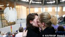 Two women kiss each other in parliament's public gallery (REUTERS/F. Bensch)