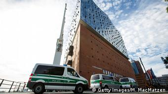 Police cars stand in front of the Elbphilharmonie concert hall