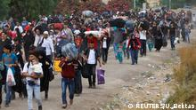 Syrians, who say they are returning to Syria ahead of Eid al-Fitr, carry their belongings as they walk to the Turkish Cilvegozu border gate located opposite of the Syrian crossing point of Bab al-Hawa in Reyhanli, in the southern Hatay province, Turkey June 14, 2017. REUTERS/Umit Bektas