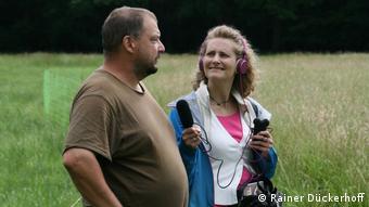 DW reporter Brigitte Osterath interviewing shepherd Holger Benning