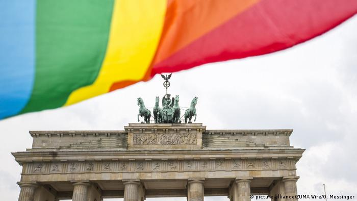A rainbow flag flies in front of the Brandenburg Gate in Berlin