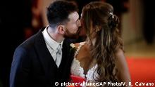 30.06.2017 Newlyweds Lionel Messi and Antonella Roccuzzo kiss while posing for photographers on the red carpet after tying the knot in Rosario, Argentina, Friday, June 30, 2017. About 250 guests, including teammates and former teammates of the Barcelona star, attended the highly anticipated ceremony. (AP Photo/Victor R. Caivano)