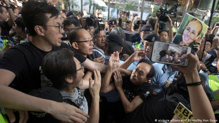Pro-Beijing protesters clashed with pro-democracy protesters during a march to the venue where official ceremonies were held