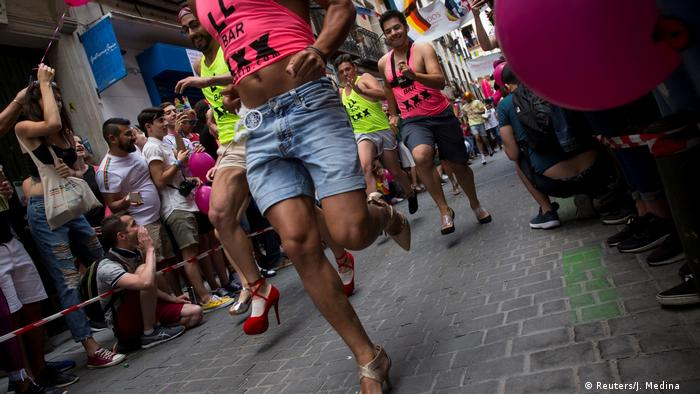 Contestants take part in the annual race on high heels during World Pride celebrations in the quarter of Chueca in Madrid, Spain