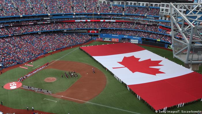 General view of Rogers Centre as a large Canadian flag is unfurled in the outfield on Canada Day (Getty Images/T. Szczerbowski)