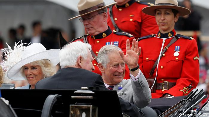 Britain's Prince Charles waves as he rides with Camilla, Duchess of Cornwall (L) and Governor General David Johnston during Canada Day celebrations on Parliament Hill (Reuters/C. Wattie)