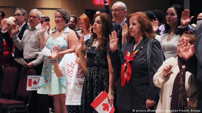People take the citizenship oath at Pier 21 immigration centre in Halifax on Saturday (picture-alliance/The Canadian Press/A. Bresge)