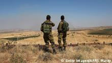 24.06.2017 Israeli soldiers patrol near the border with Syria after projectiles fired from the war-torn country hit the Israeli occupied Golan Heights on June 24, 2017. An Israeli aircraft carried out a strike on Syria after 10 projectiles hit the occupied Golan Heights, an army spokesman said. The Israeli Air Force also targeted two tanks of the Syrian regime in the northern part of the Golan, the spokesman said, adding the projectiles did not cause any casualties. / AFP PHOTO / JALAA MAREY (Photo credit should read JALAA MAREY/AFP/Getty Images)