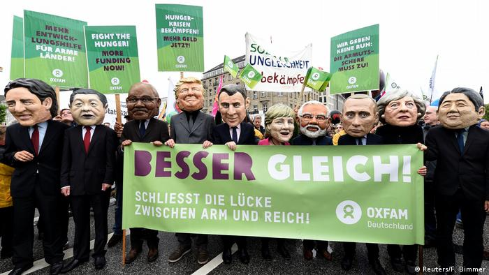 Oxfam's Big Heads depict G20 leaders take part in protests ahead of the upcoming G20 summit in Hamburg