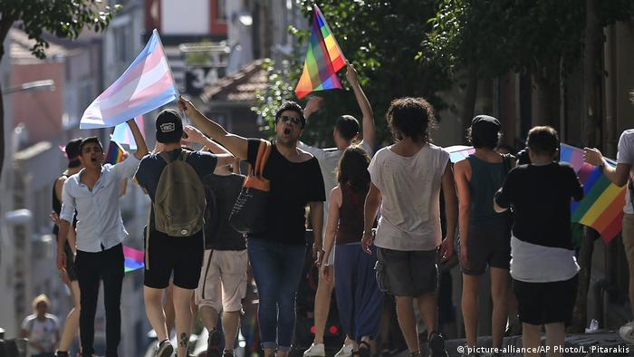 LGBTI activists disperse to avoid detention by Turkish police officers in Istanbul